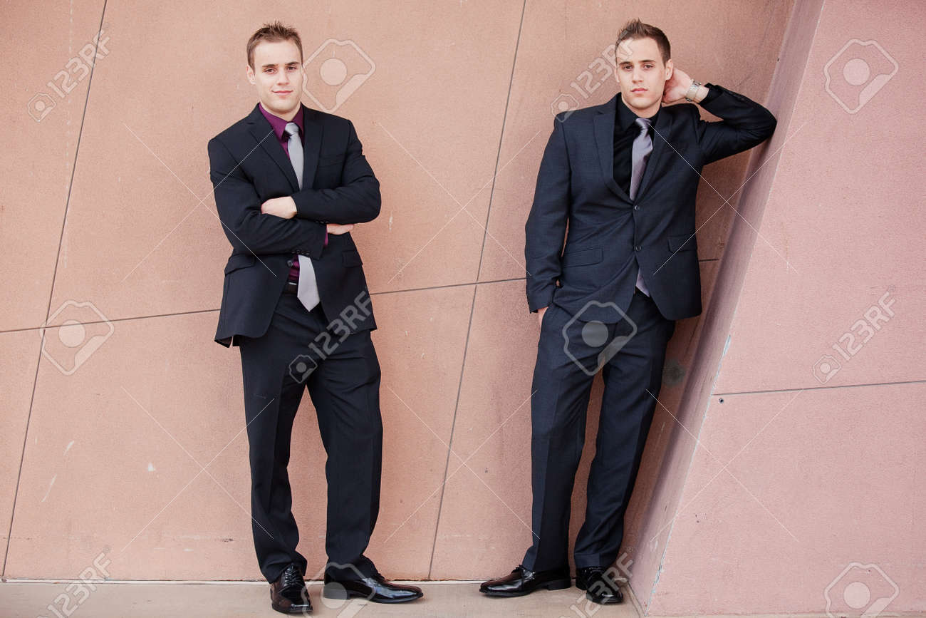13647061-Handsome-young-businessmen-lean