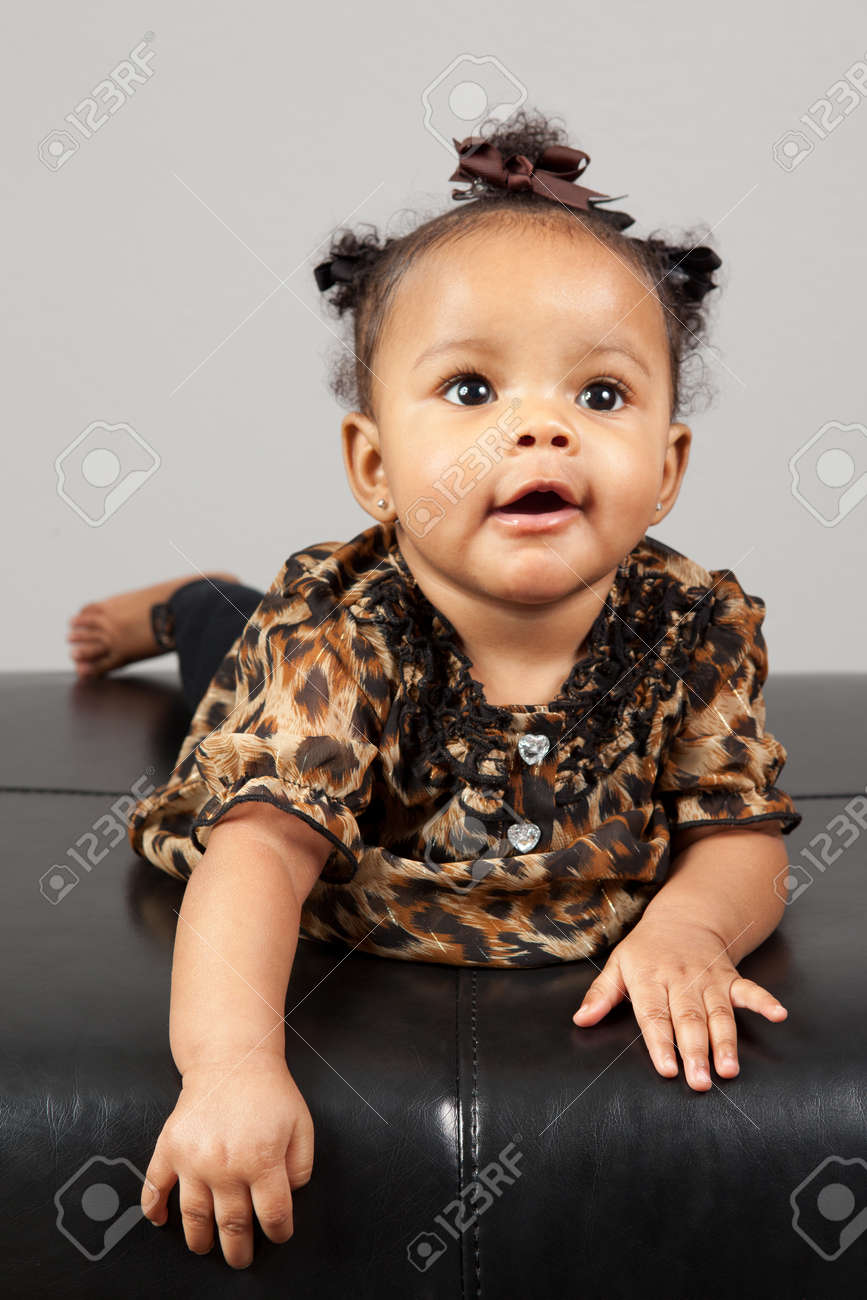Portrait of beautiful 6 month old African American Baby Stock Photo -  14334544