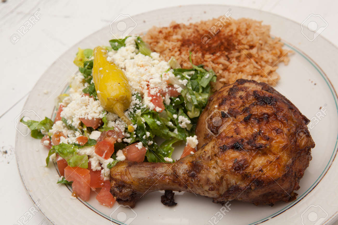 Plate Of Roasted Chicken Saffron Rice And Greek Salad Stock Photo Picture And Royalty Free Image Image 17655659