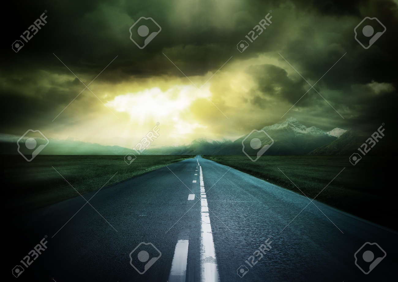 New Horizons. Long old country road with mountains. Stock Photo - 8010958
