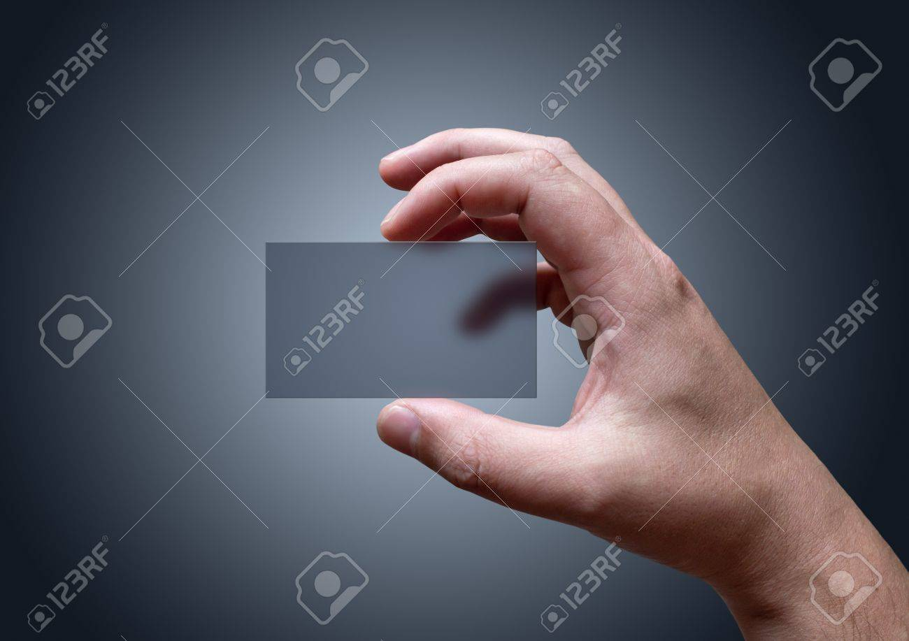A Hand Holding Blank Transparent Business Card Stock Photo