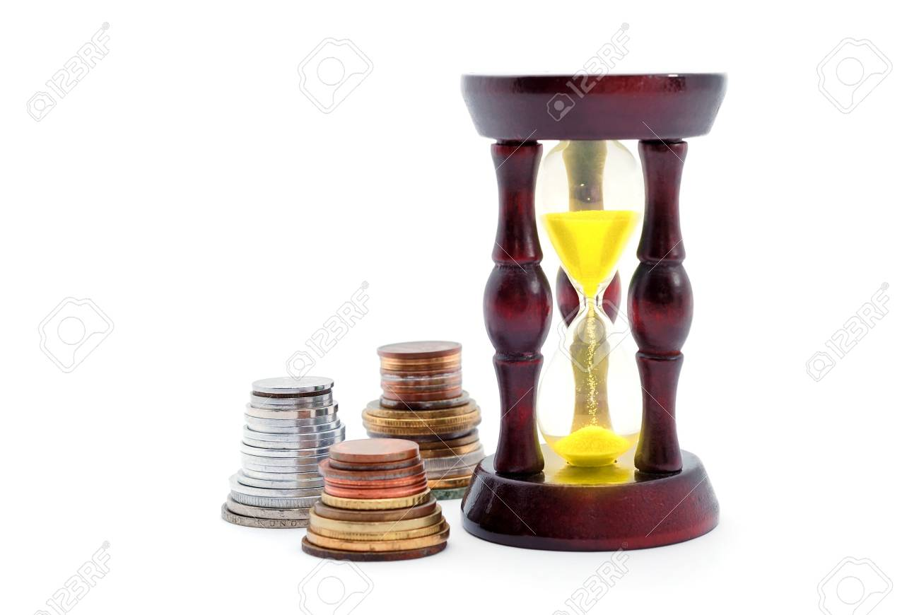 Sand watch and background of money on white Stock Photo - 4742023
