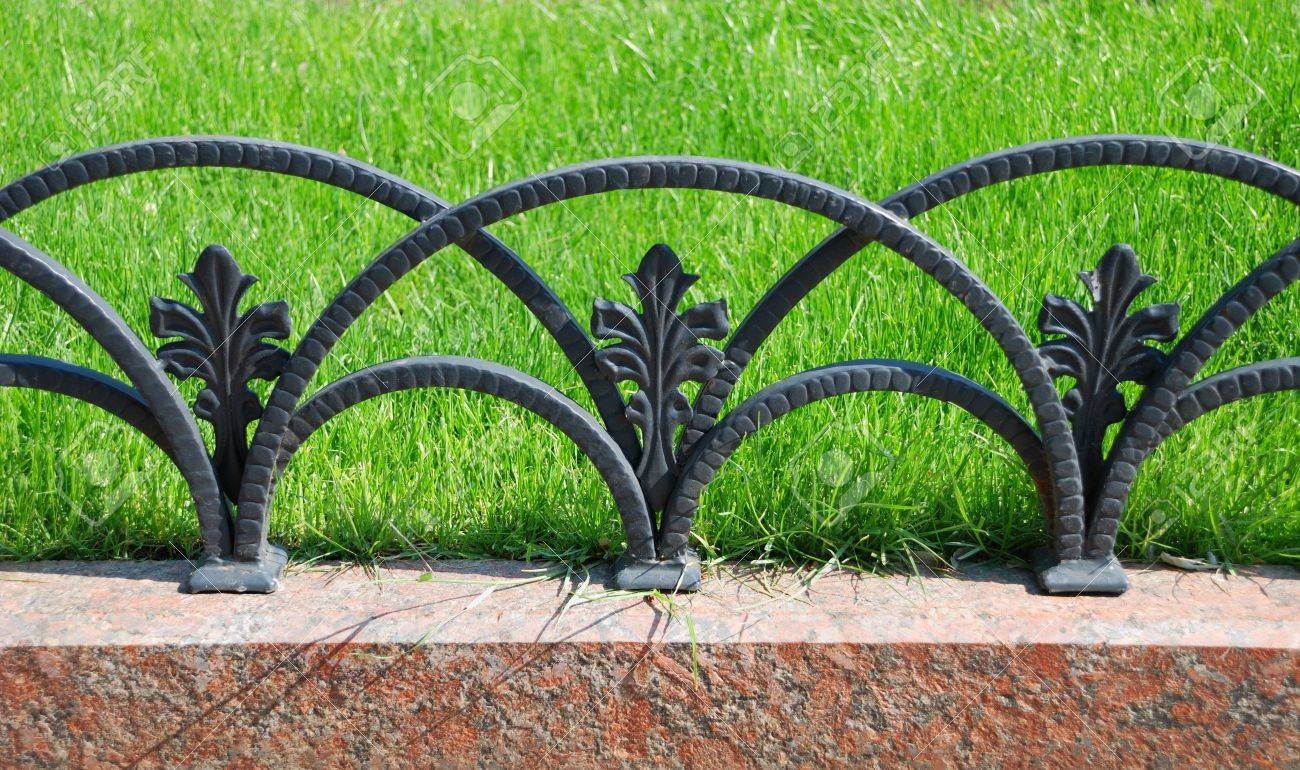 Picture of: Decorative Fencing Near Sidewalk In Park And One Yellow Flower Stock Photo Picture And Royalty Free Image Image 5424510
