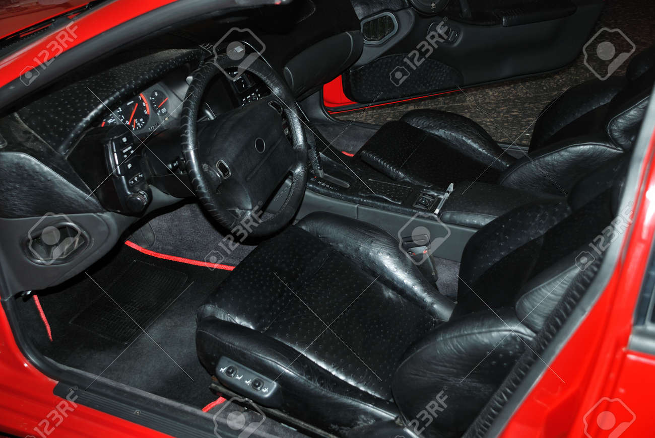 Interior of salon of the red car with a leather upholstery Stock Photo - 5431125
