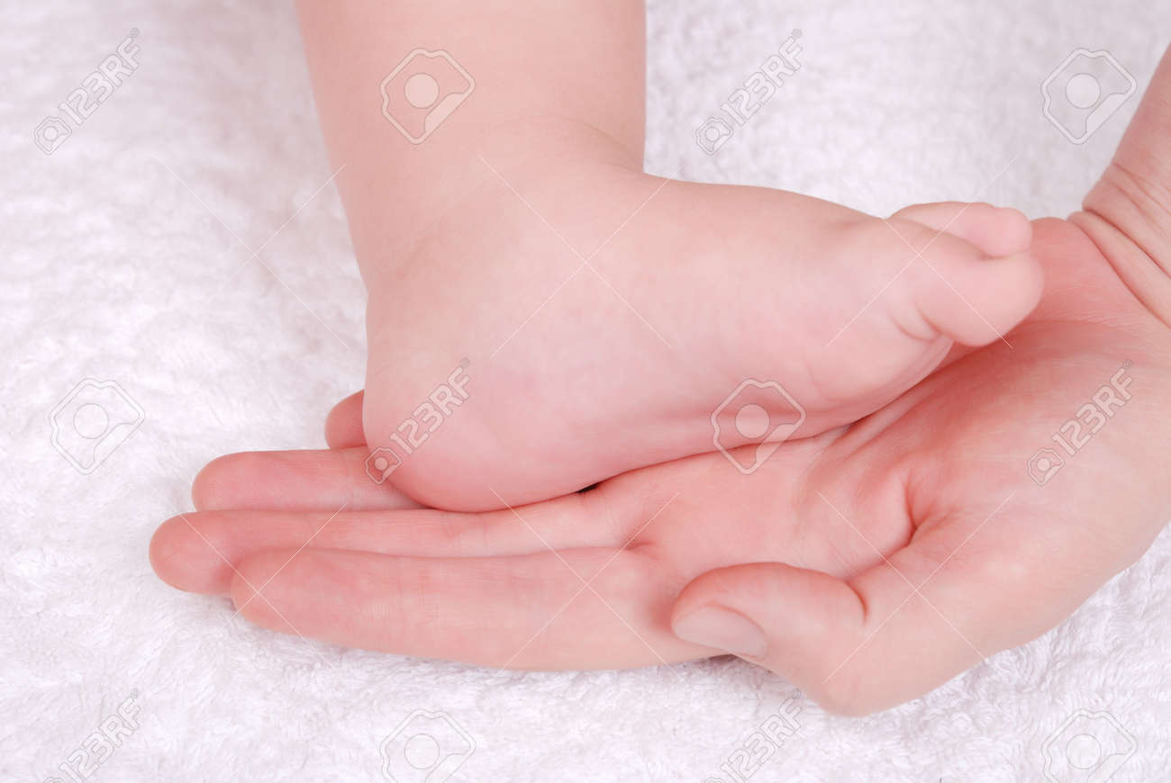 The caucasian baby feet in mommy's hands Stock Photo - 6009454