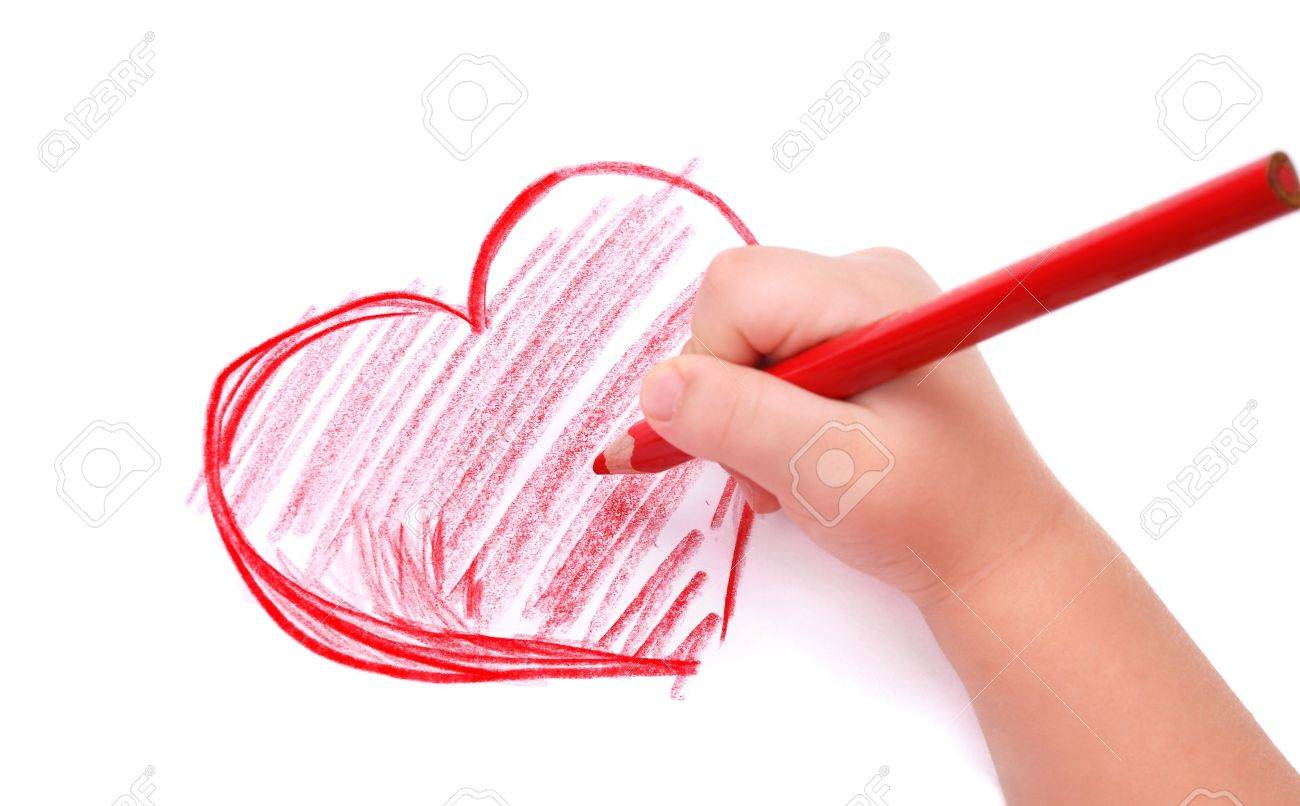 Childrens hand with pencil draws the heartl, isolated Stock Photo - 7415773