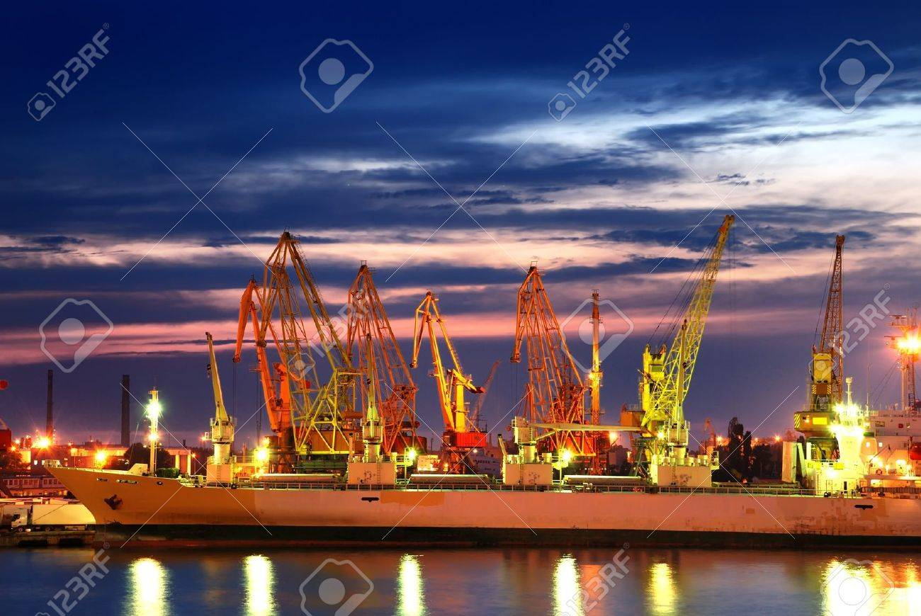 Port warehouse with cargoes and containers at night Stock Photo - 7526585