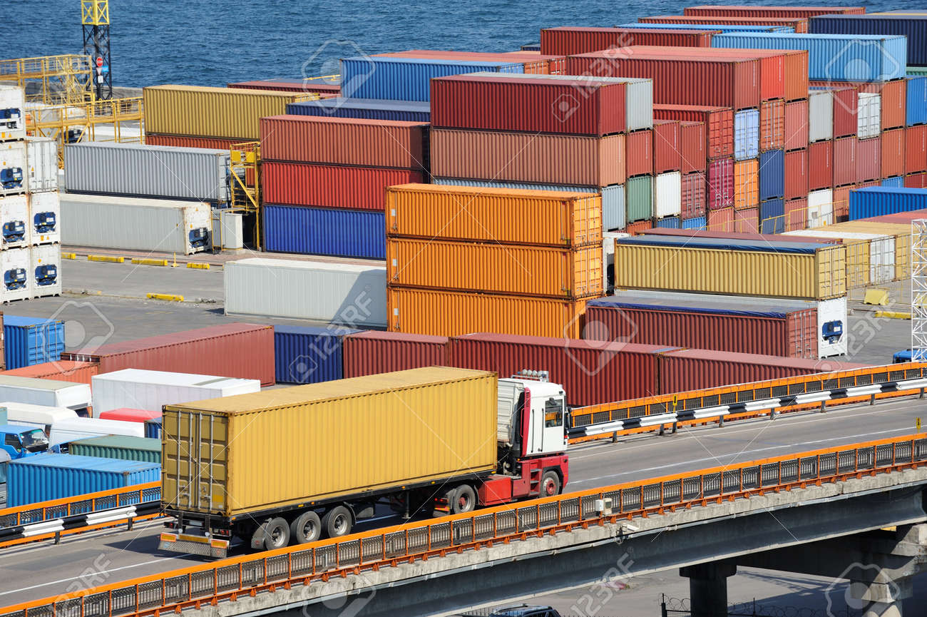 truck transport container to a warehouse near the sea - 14763487
