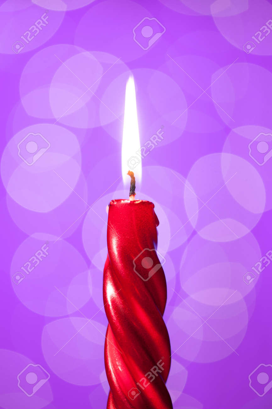 red candle light on violet background with bokeh Stock Photo - 16582225