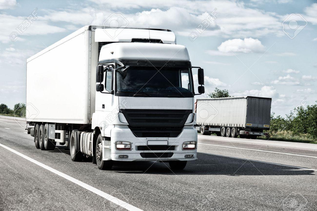 White truck on road. Cargo transportation - 35914327