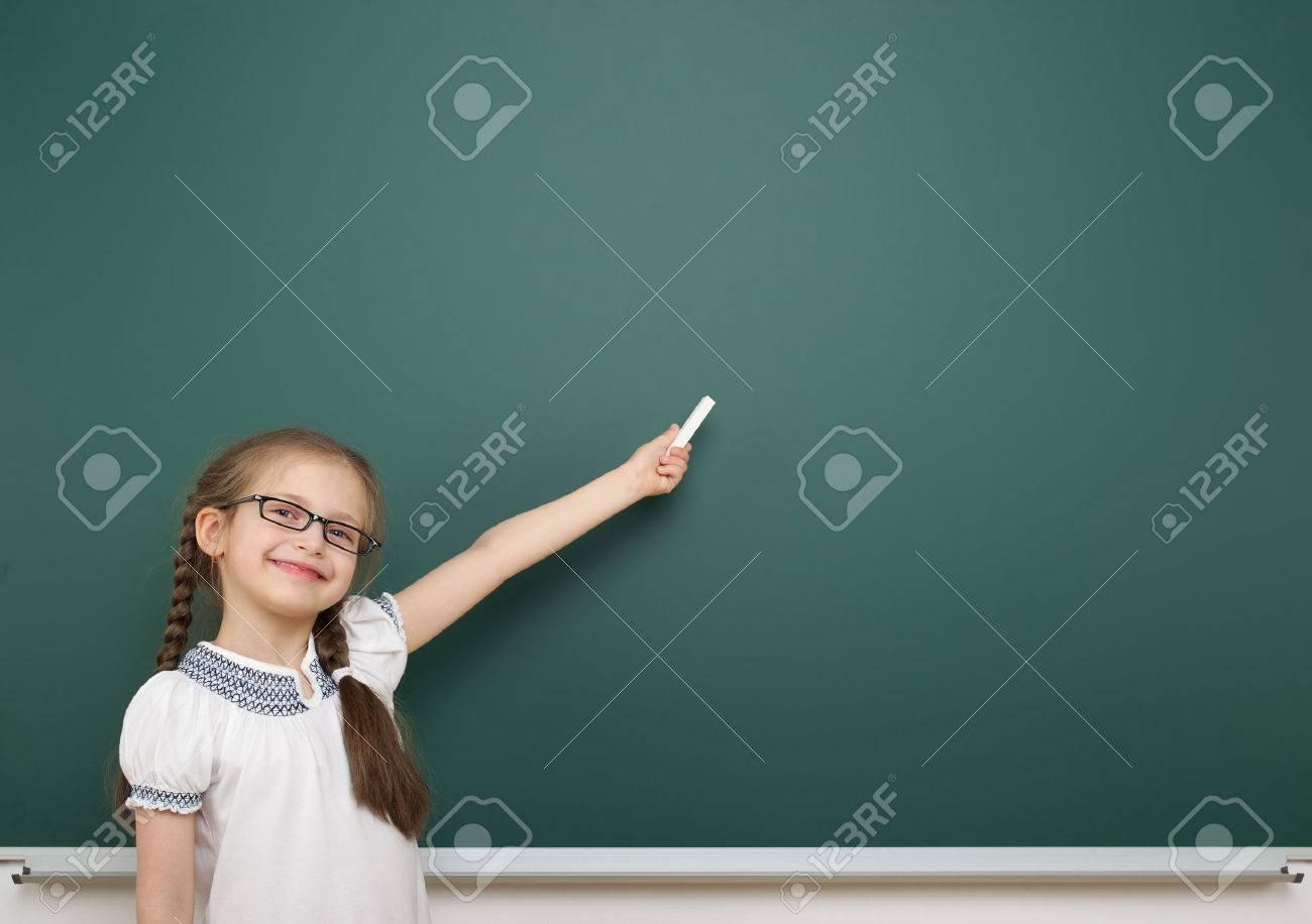 Schoolgirl near the school board - 42124043