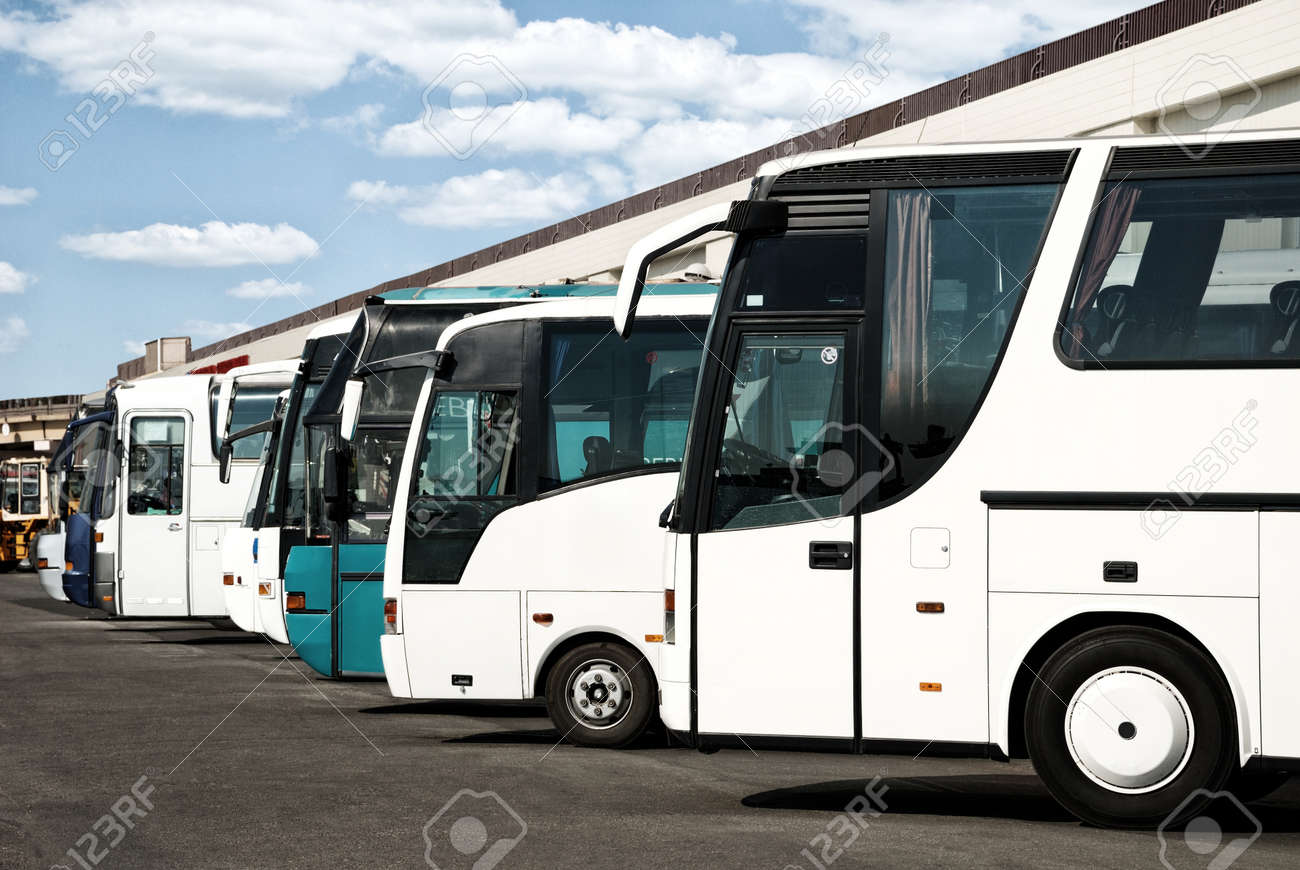 buses at the bus station with cloudy sky - 54591047