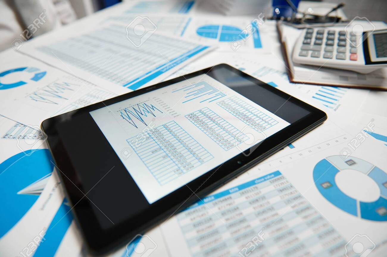 Office workspace for business. Tablet pc and reports. Table closeup. Business financial accounting concept. - 126666027
