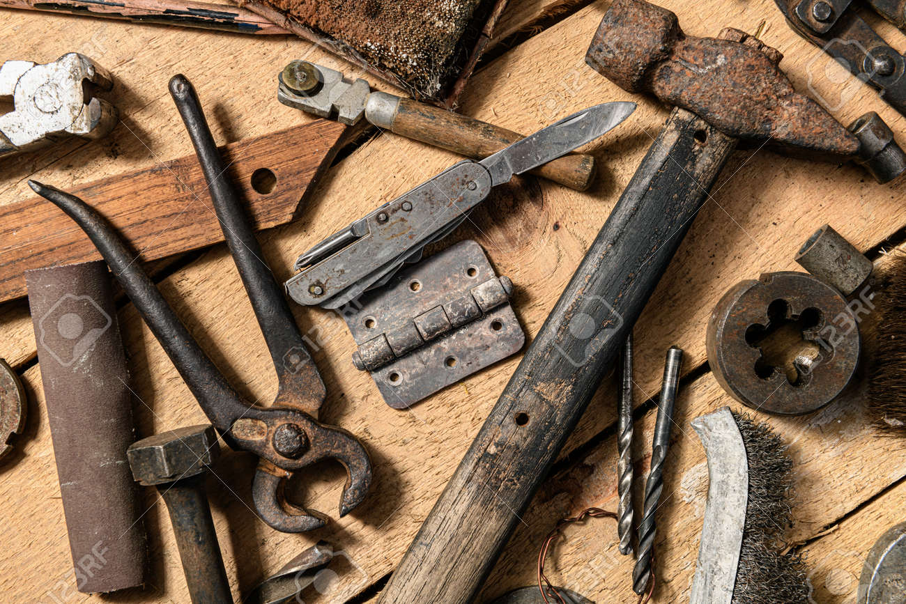 Old vintage household hand tools still life on a wooden background in a DIY and repair concept - 157912762