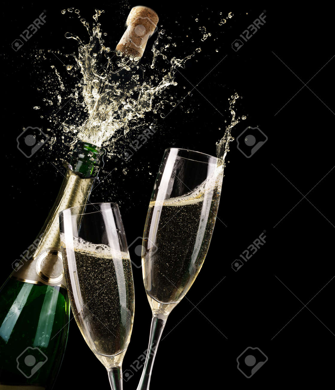 popping champagne and toast of midnight stock photo picture and
