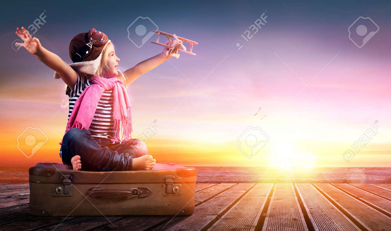 Dream journey - Little Girl On Vintage Suitcase At Sunset - 54425360