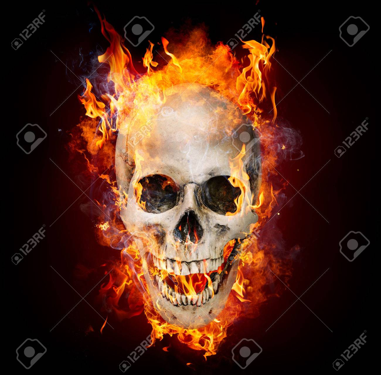 Fire skull stock photos royalty free fire skull images satanic skull in flames in the darkness stock photo voltagebd Choice Image