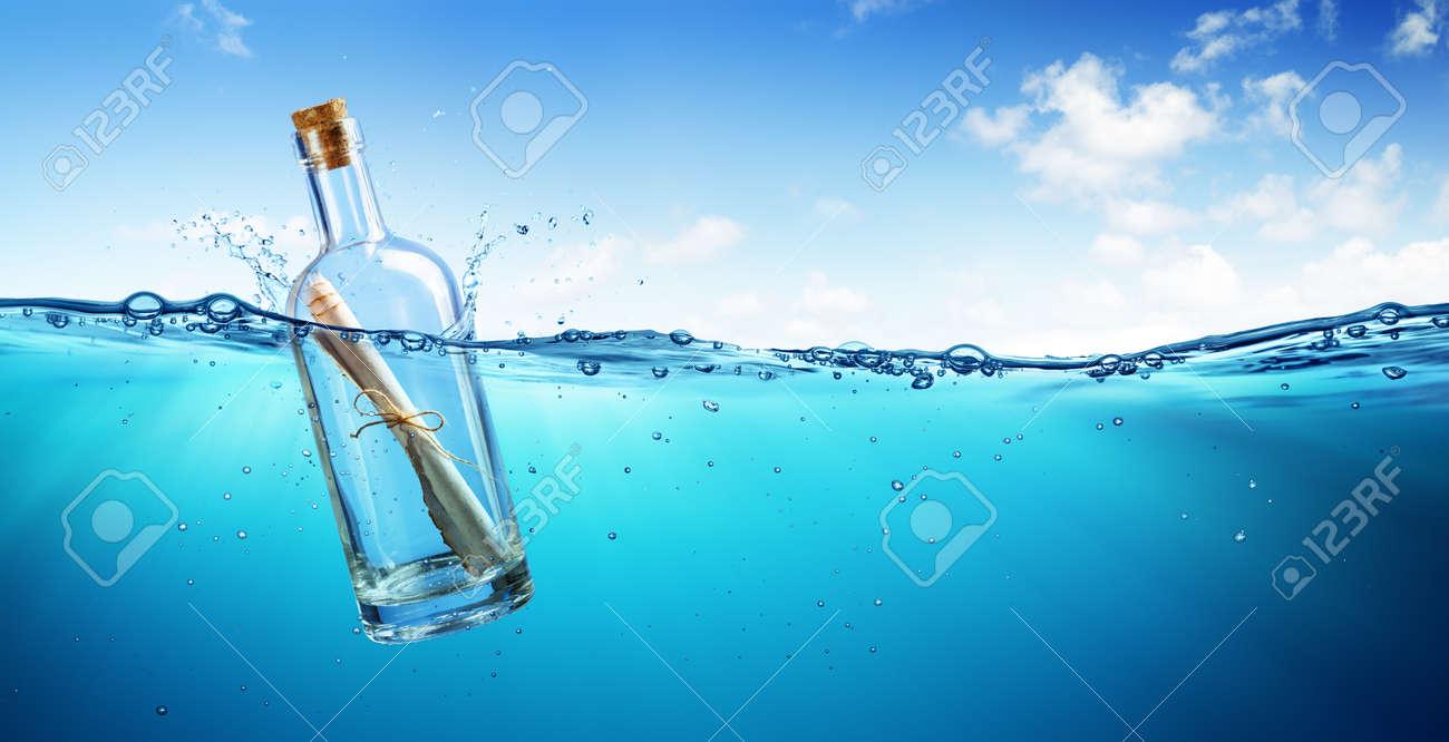 Message In Bottle Floating In The Ocean - 81741303
