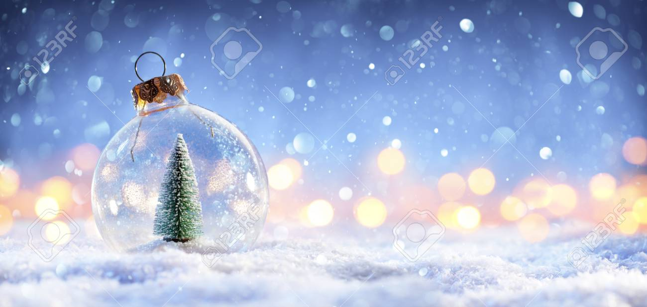 Snow Ball With Christmas Tree In It And Lights On Winter Background - 114447959