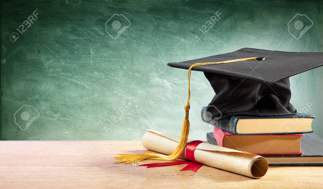 Graduation Cap And Diploma On Table With Books - 125945055