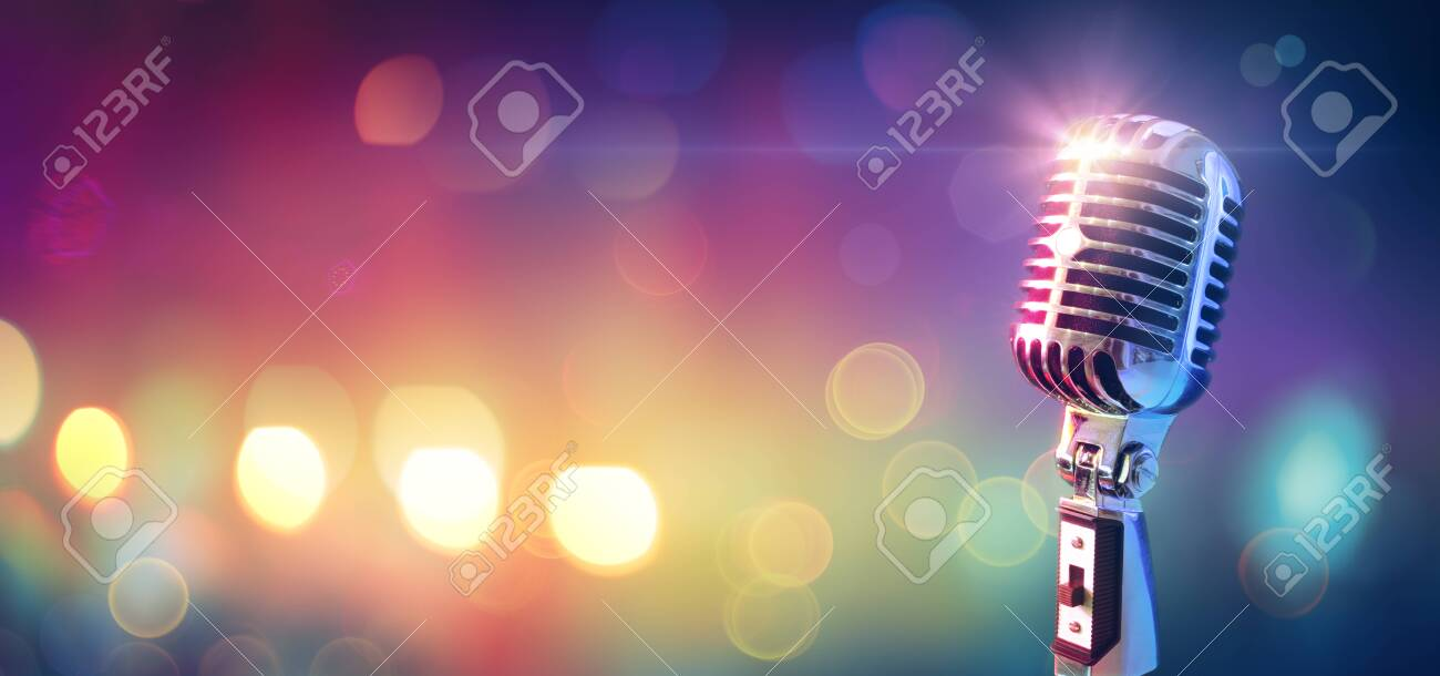 Retro Microphone On Stage With Bokeh Light - 128858750