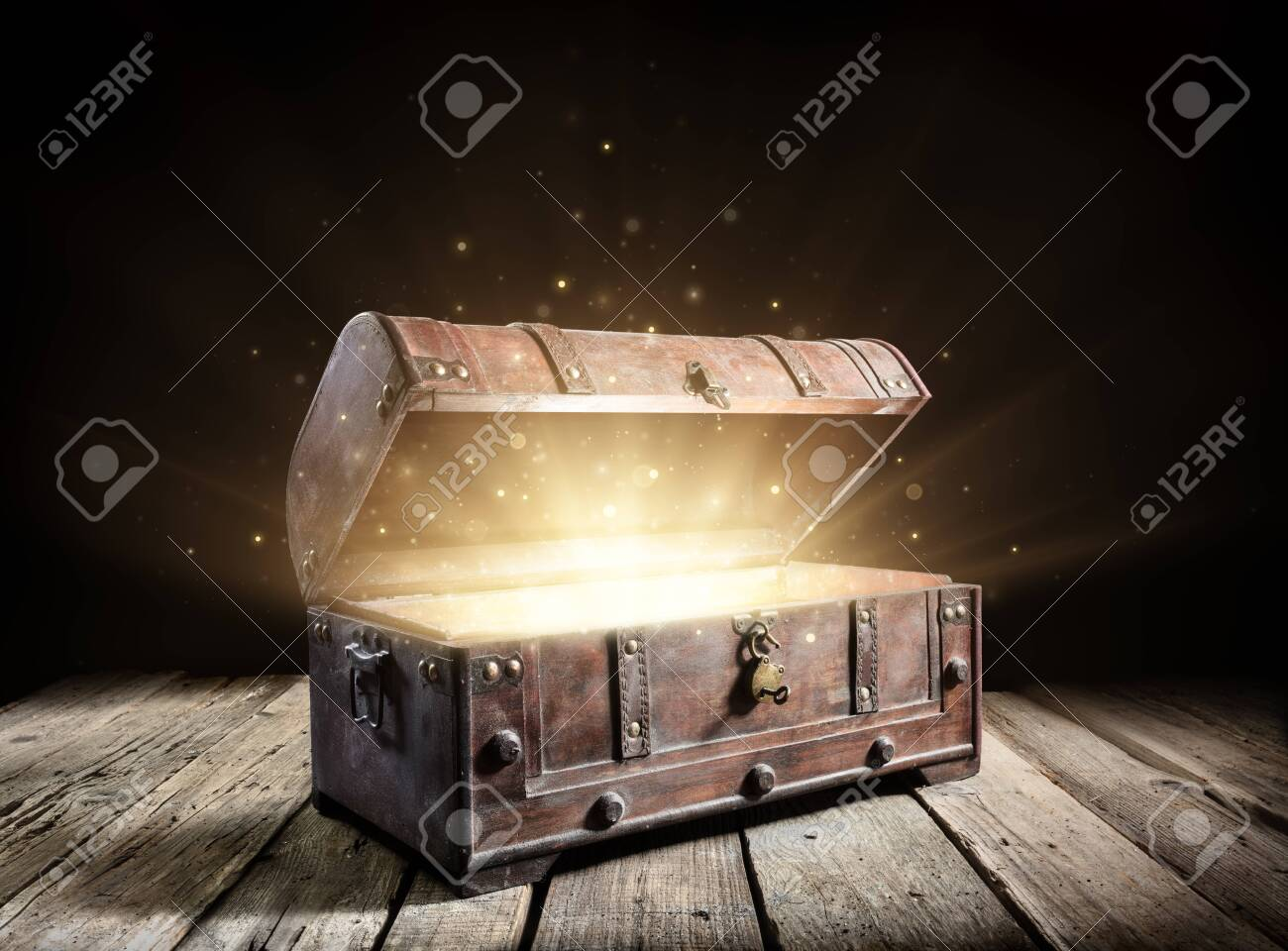 Treasure Chest - Open Ancient Trunk With Glowing Magic Lights In The Dark - 128858779