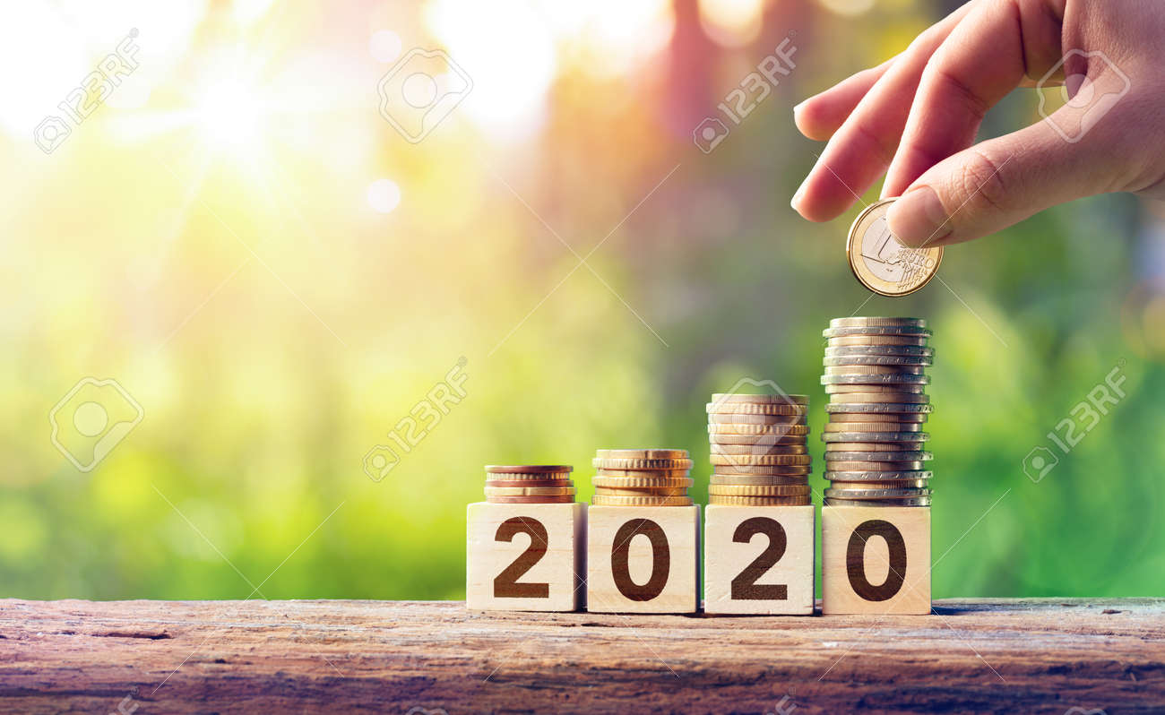Growth Forecast Concept For 2020 - Coins Stack On Wooden Blocks - 129764462