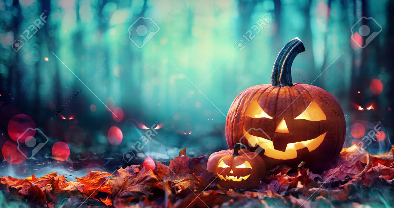 Jack O 'Lanterns On Red Leaves In Spooky Forest With Defocused Ghosts - 154194300
