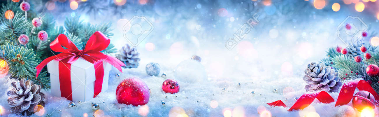 Christmas Present And Ornaments On Defocused Background And Bokeh Lights - 157151871