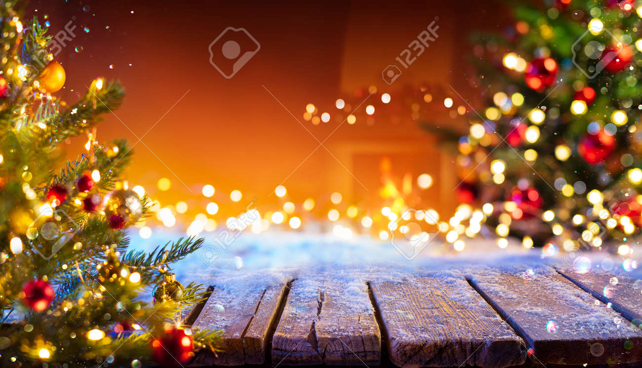 Wooden Table With Snow And Defocused Christmas Tree - Abstract Background - 158081941