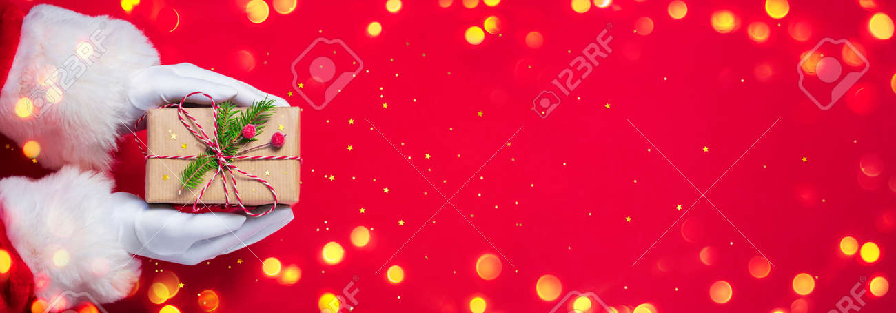 Santa Claus Give Handmade Present In Red Background - Christmas - 158081780