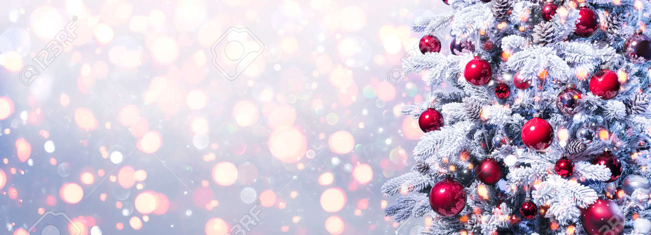 Abstract Holiday Background - Snowy Christmas Tree With Red Baubles With Shiny Defocused Lights - 159435969