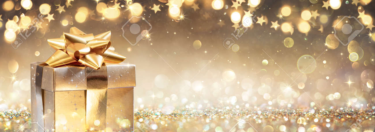 Golden Gift Box On Glitter In Abstract Background With Defocused Lights - 159435980