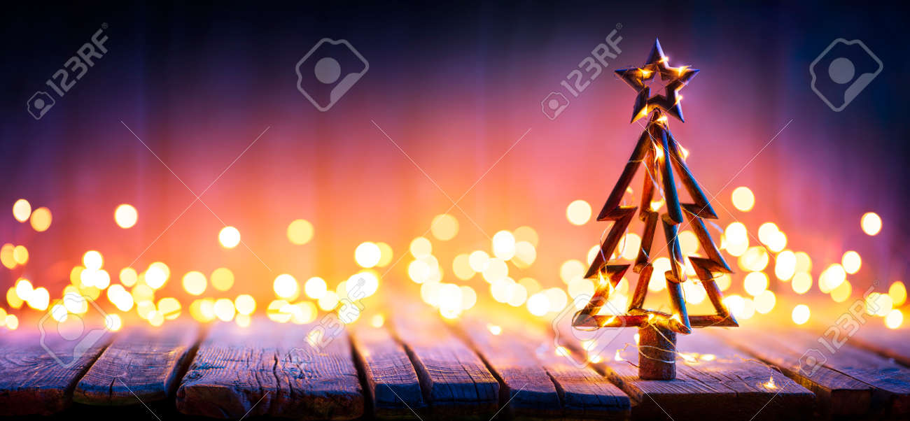 Christmas Light And Wooden Tree On Table With Defocused Rustic Background - 159435984