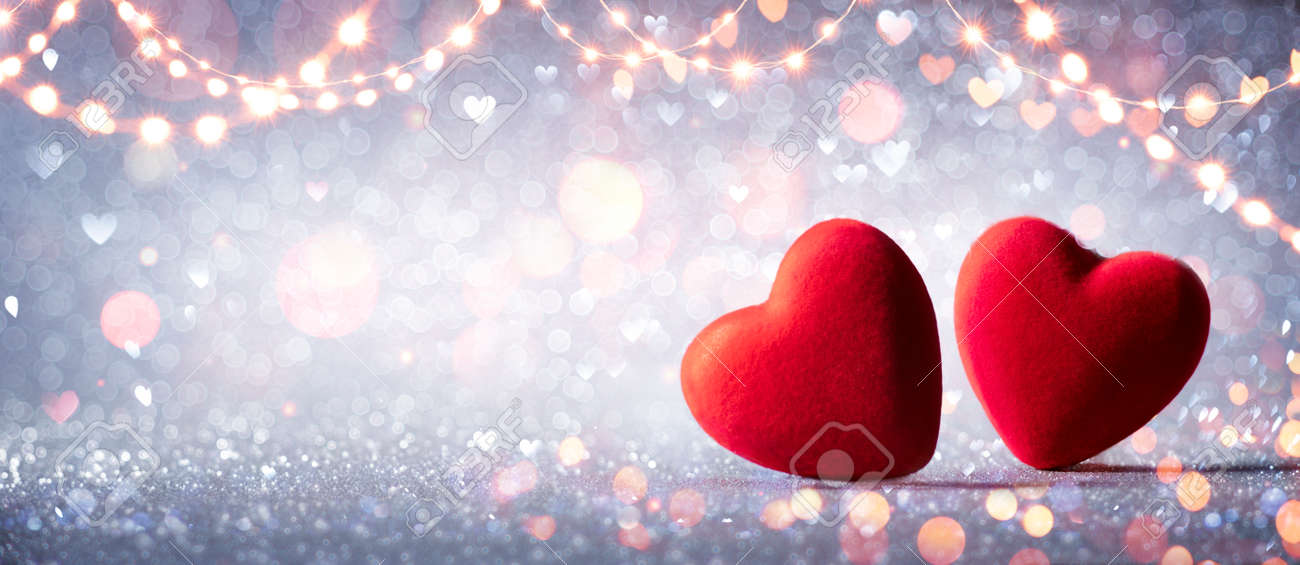 Two Hearts In Love On Silver Glitter With Abstract Defocused Background - 162813982