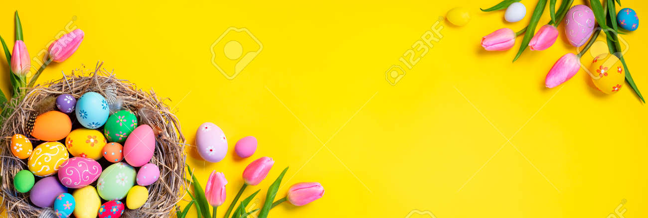 Easter - Decorated Eggs In Nest With Pink Tulips In Yellow Background - 164196240