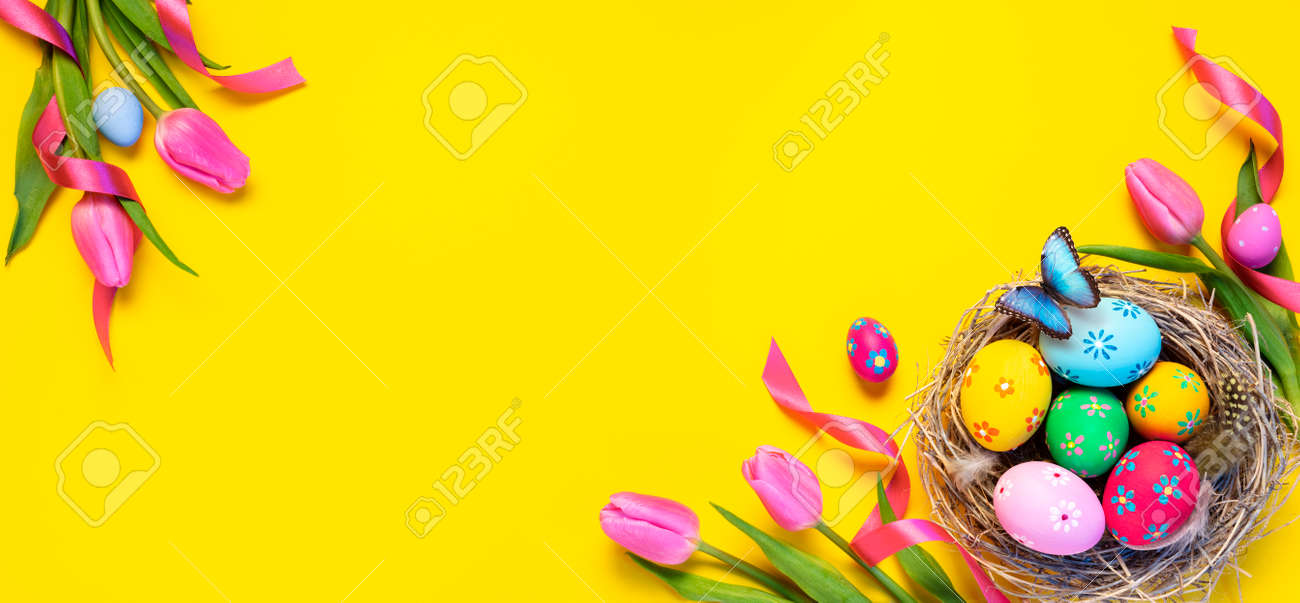 Easter - Colorful Eggs In Nest With Butterfly And Pink Tulips In Yellow Background - 165476402
