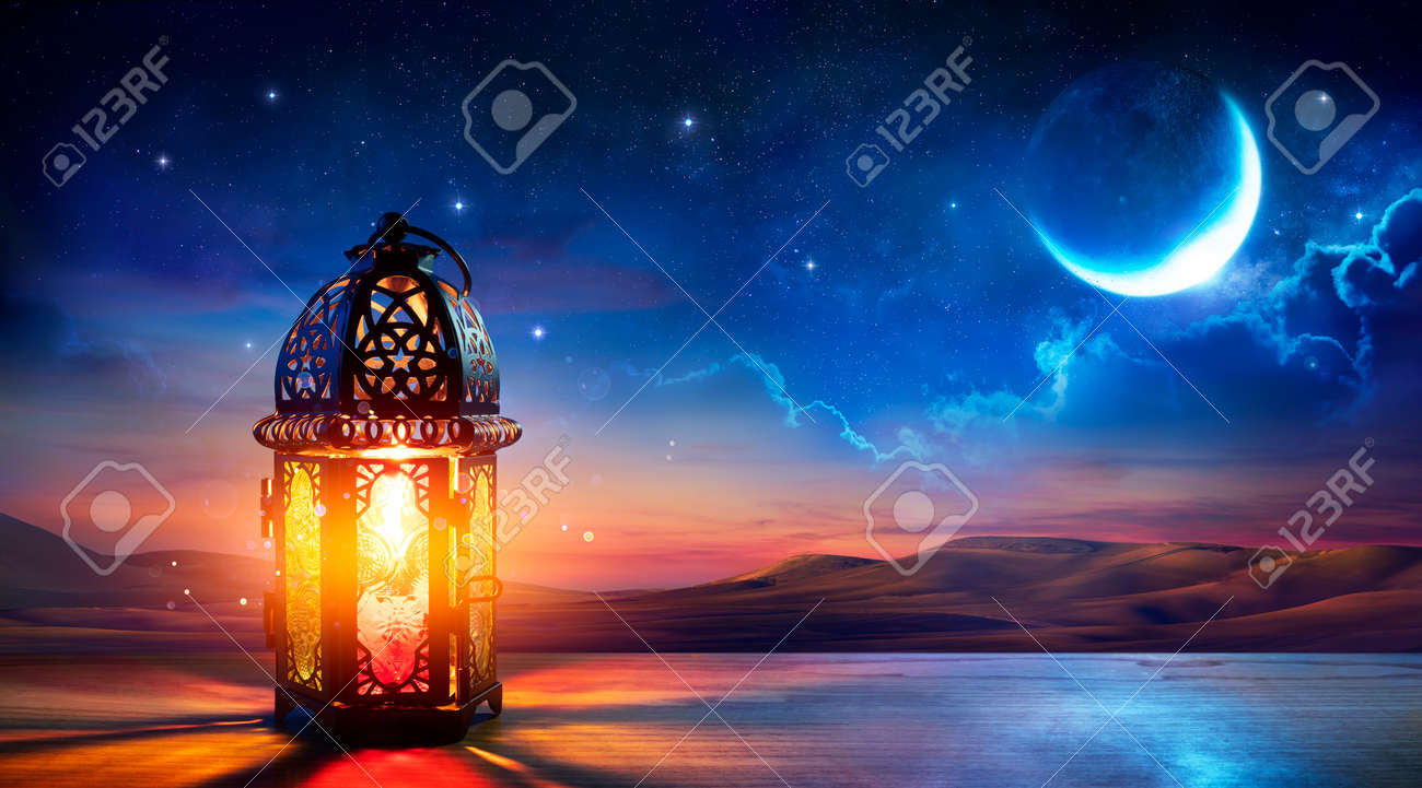 Muslim Holy Month Ramadan Kareem - Ornamental Arabic Lantern With Burning Candle Glowing At Evening - Eid Al Fitr - 168103926