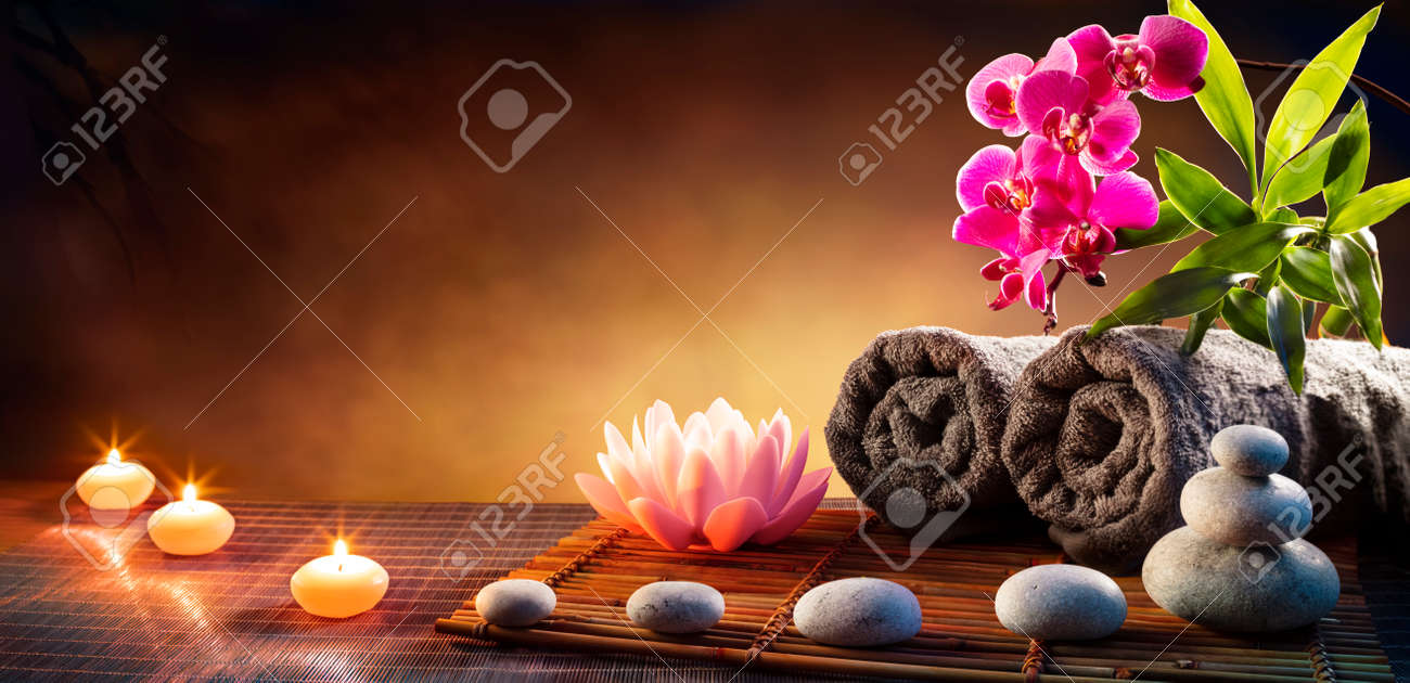 Spa Massage Treatment With Towels And Candles On Mat - 169657750