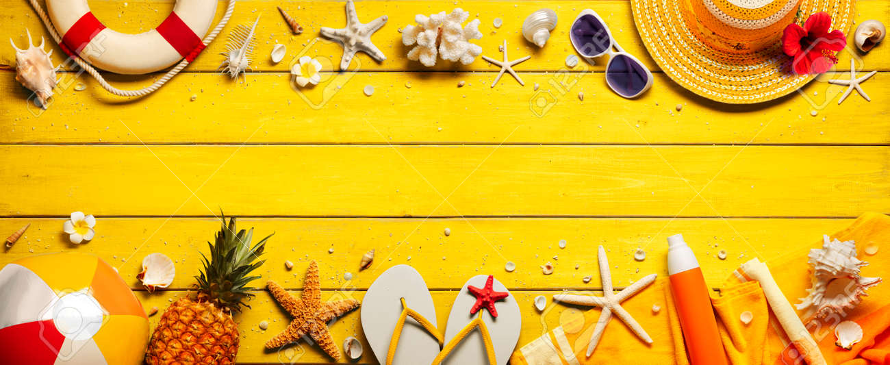 Yellow Beach Background With Accessories On Wooden Table - 169657762