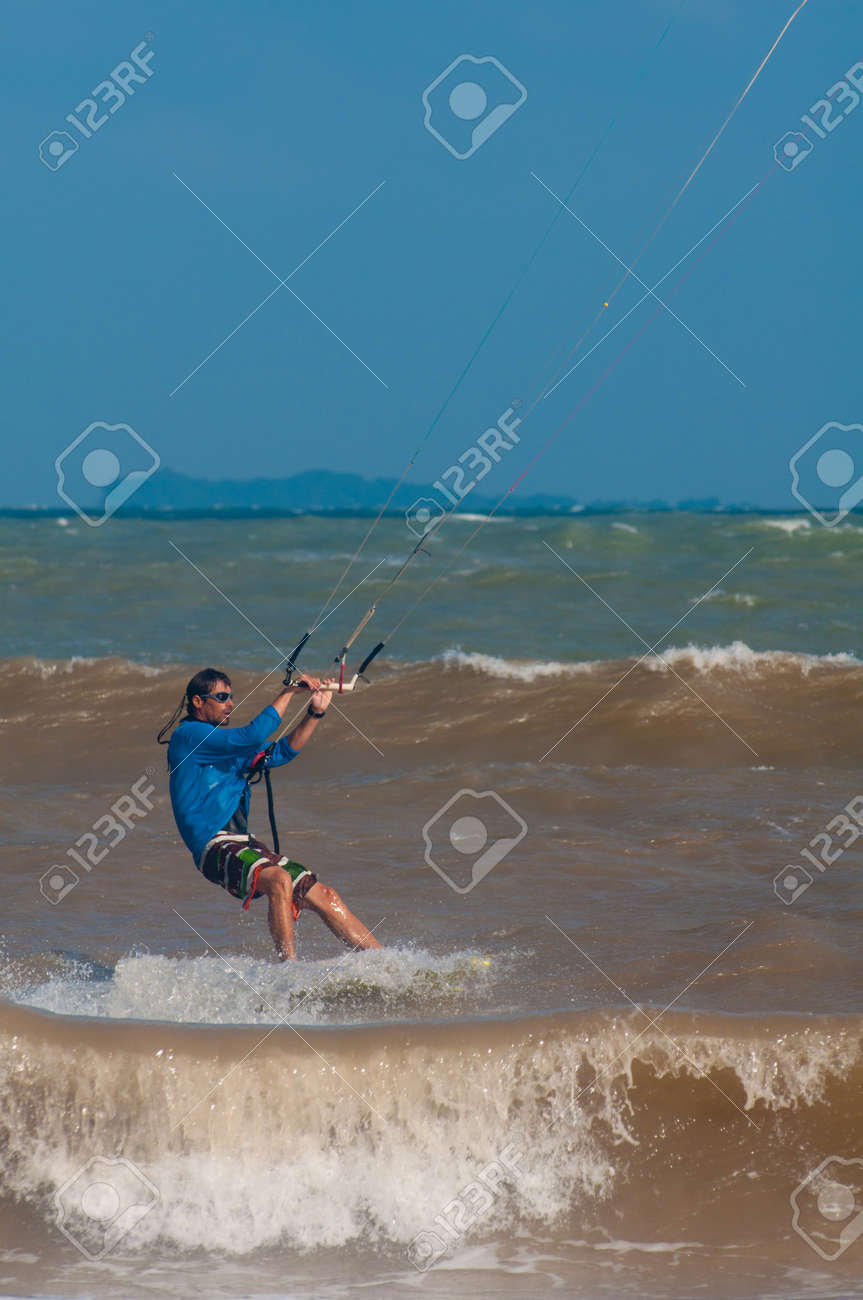 kitesurfing on the waves of the Chumpon in Thailand Stock Photo - 17003345