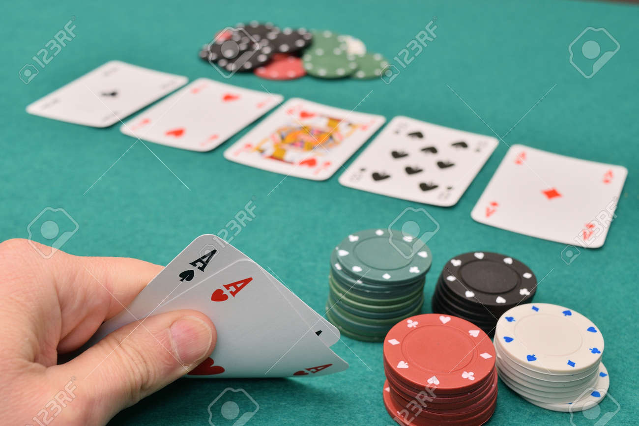 aces pair on a gambling table with chips - 90701170