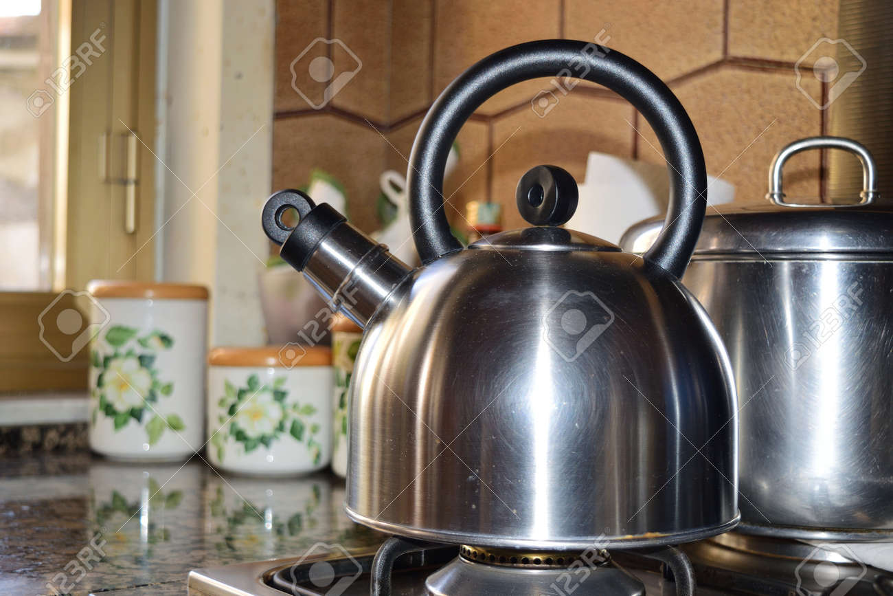 close up of a teapot on the stove - 99820865