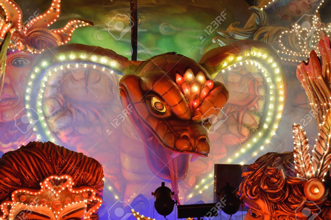 Acireale (CT), Italy - February 16, 2020: detail of a allegorical float depicting the head of a snake during the carnival parade along the streets of Acireale. - 141805570