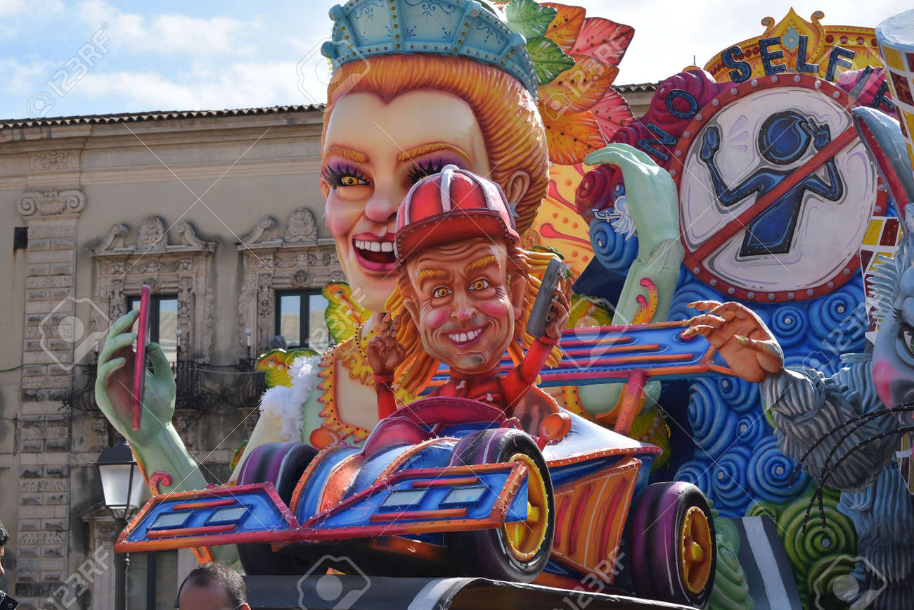 Acireale (CT), Italy - February 16, 2020: detail of a allegorical float depicting a race car driver during the carnival parade along the streets of Acireale. - 141805575