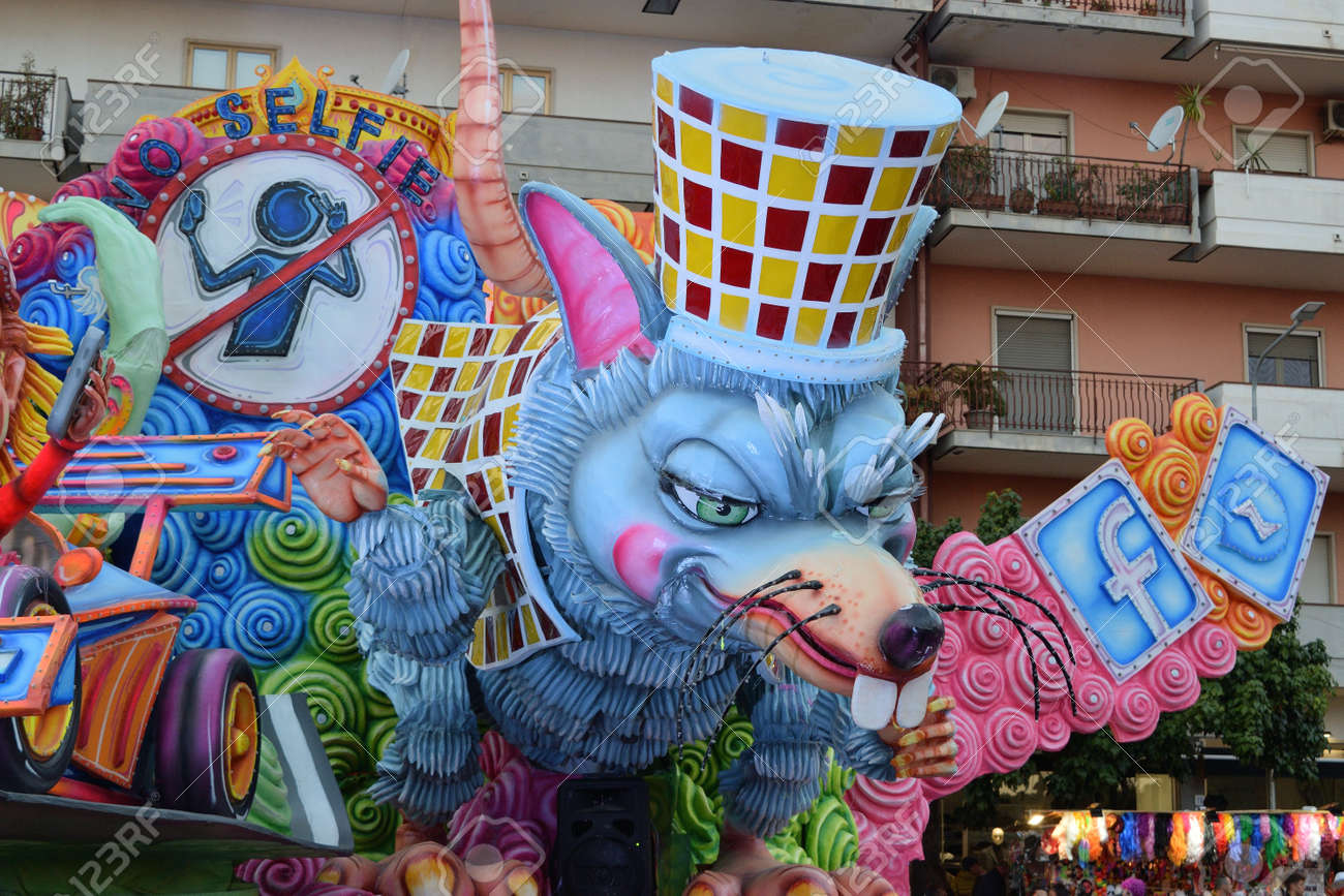 Acireale (CT), Italy - February 16, 2020: detail of a allegorical float depicting a mouse during the carnival parade along the streets of Acireale. - 141805578