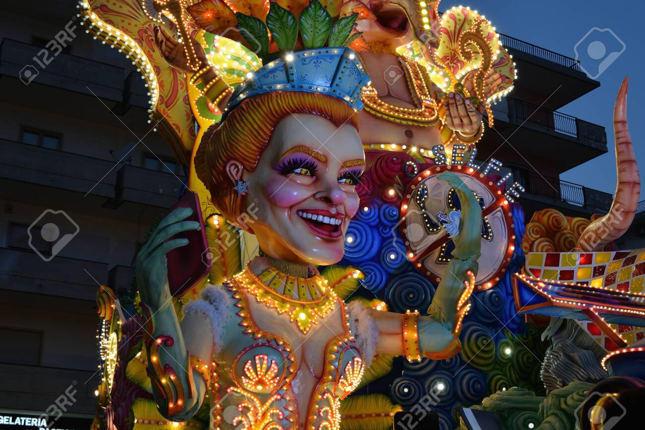 Acireale (CT), Italy - February 16, 2020: detail of a allegorical float depicting a woman during the carnival parade along the streets of Acireale. - 141805604