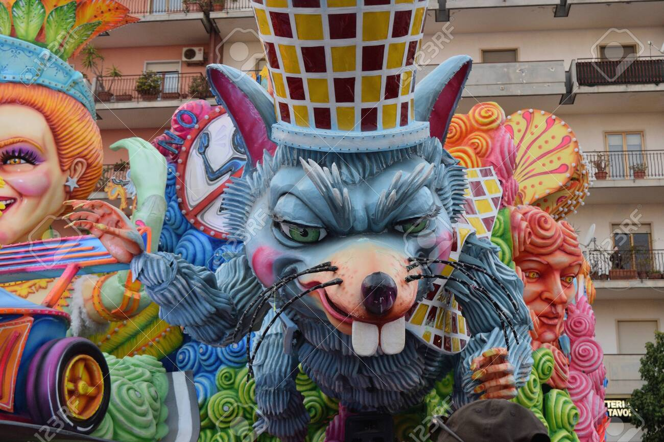 Acireale (CT), Italy - February 16, 2020: detail of a allegorical float depicting a mouse during the carnival parade along the streets of Acireale. - 141805606