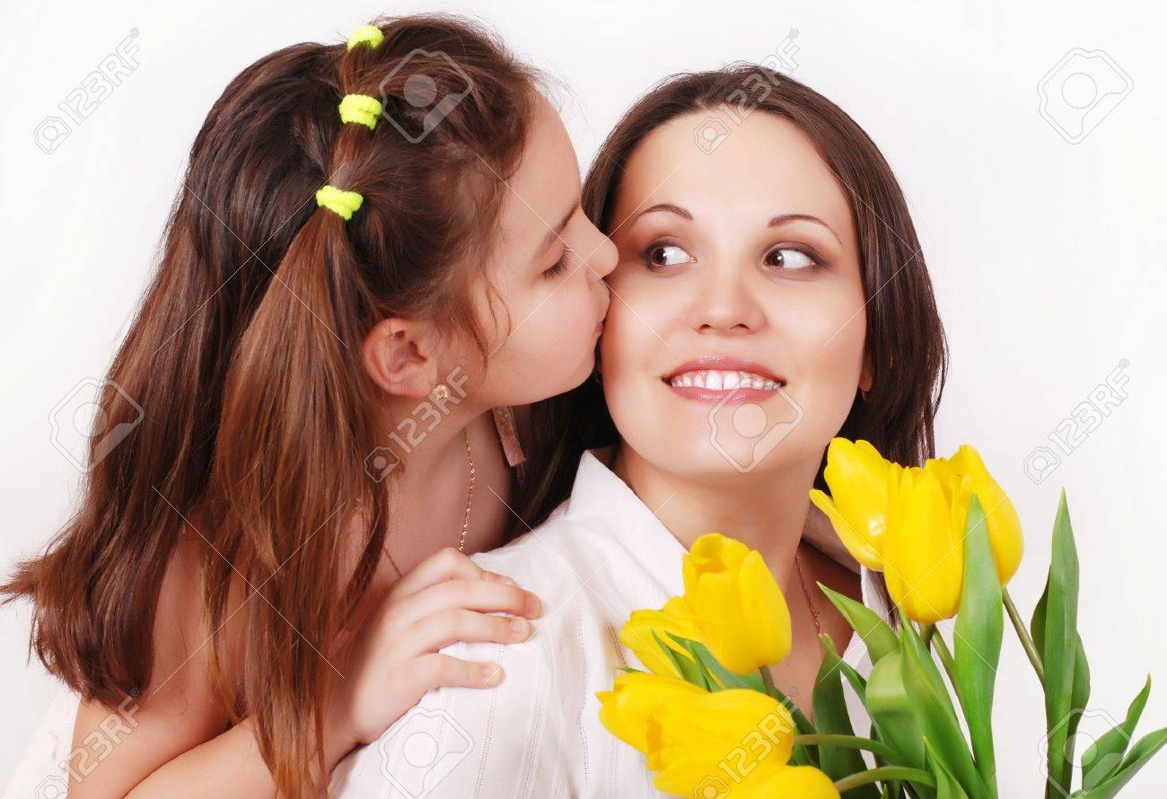 Portrait of Daughter kissing her mother Stock Photo - 12600296
