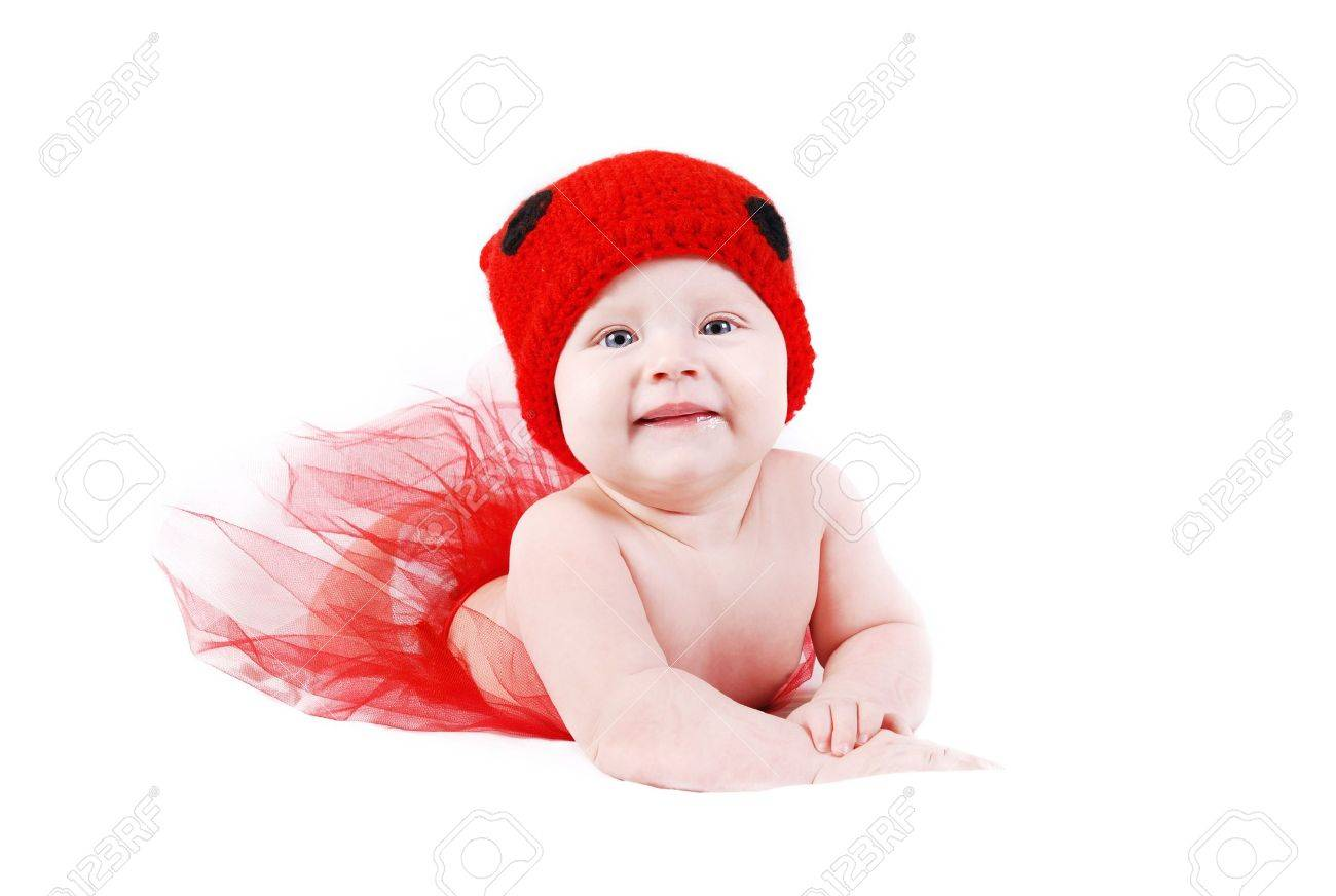 Adorable baby girl in red tutu and ladybug hat lying on white background Stock Photo - 13115582